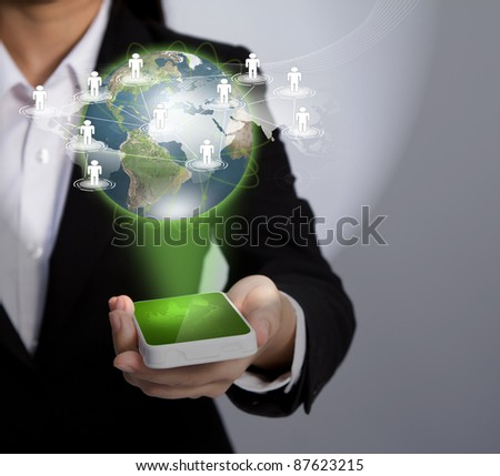 Hand holding a phone show Earth and social network - stock photo