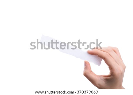 hand holding a piece of blank torn notepaper