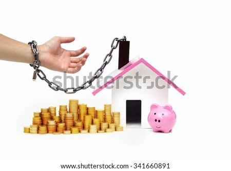 hand holding a pile of banknote and chained with a house - burden and long term debts of buying a new house concept