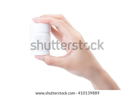 Hand holding a pill bottle isolated on white with clipping path.
