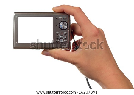 Hand holding a point and shoot camera - stock photo