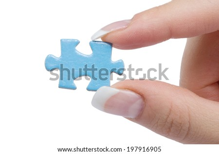 hand holding a puzzle piece