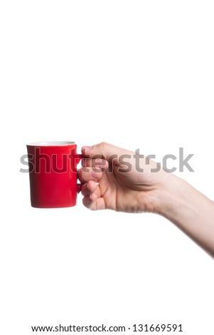 Hand holding a red cup isolated on white background. - stock photo