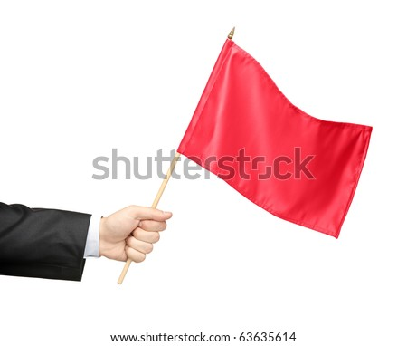 Hand holding a red flag isolated on white background - stock photo