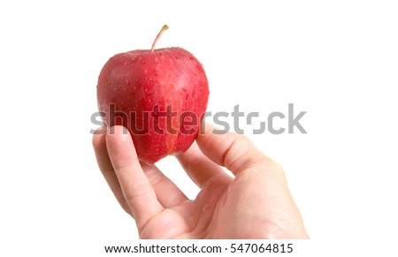 Hand holding a red fresh apple with water drops and isolated on white