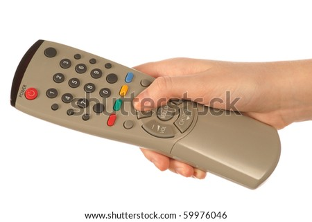 Hand holding a remote - stock photo
