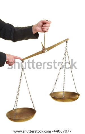 Hand holding a scale and pressing it down - stock photo