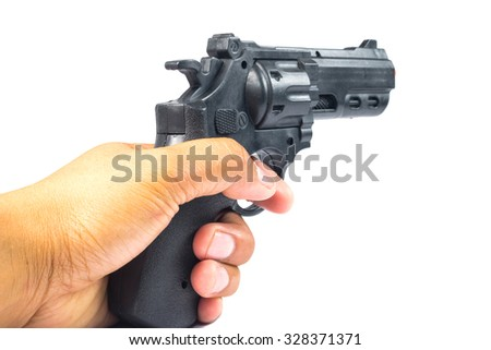 hand holding a semi automatic handgun that is in ready position to shoot
