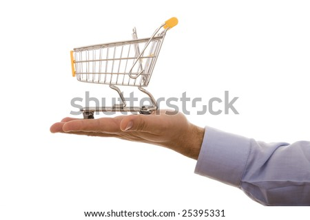 hand holding a shopping cart (selective focus) - stock photo