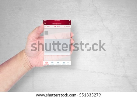 Hand holding a social network application template on grunge background.