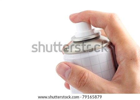 Hand holding a spray can - stock photo