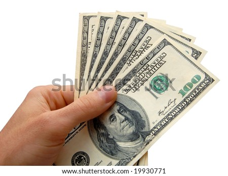 Hand holding a stack of cash, isolated on the white background - stock photo