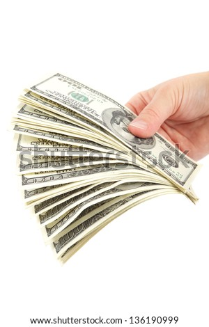 Hand holding a stack of money isolated on white background.