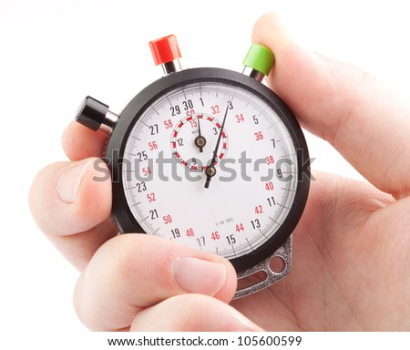 Hand holding a stopwatch - stock photo