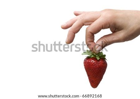 hand holding a strawberry - stock photo