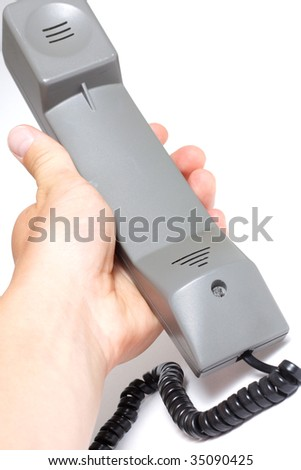 Hand holding a telephone handle