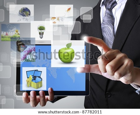 hand holding a touchpad - stock photo