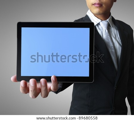 hand holding a touchpad