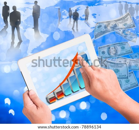 hand holding a touchpad pc with growthing graph - stock photo