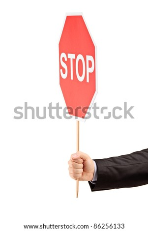 Hand holding a traffic sign stop isolated against white background - stock photo