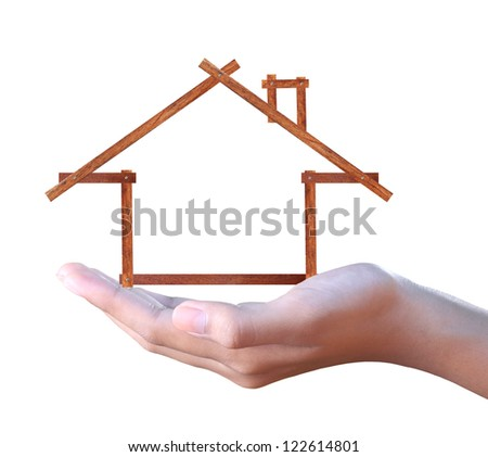 hand holding a wood house - stock photo