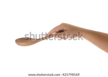 Hand holding a wooden kitchen spoon for stirring and tasting food in the kitchen, isolated on white background.