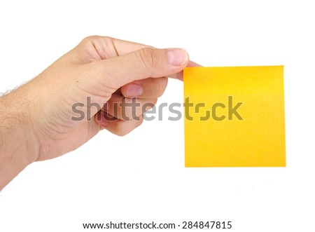 Hand holding a yellow notepaper or postit isolated on white  background