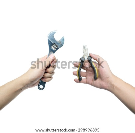 Hand holding adjustable wrench and Pliers isolated on white background  - stock photo
