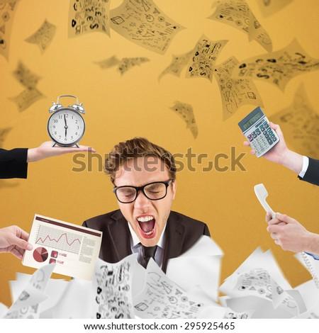 hand holding alarm clock against orange background - stock photo