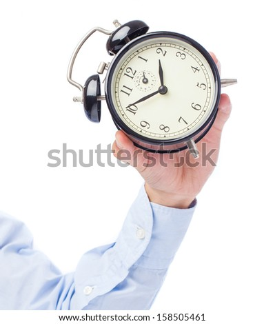 hand holding alarm clock isolated on a white background