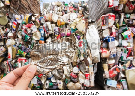 Hand holding aluminum can for recycle - stock photo