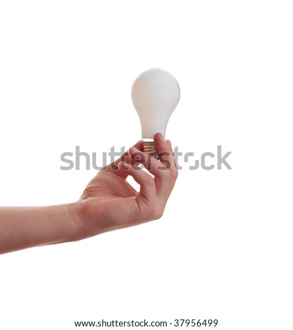 Hand holding an incandescent lightbulb, isolated on white.