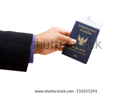 Hand holding an official passport and ticket