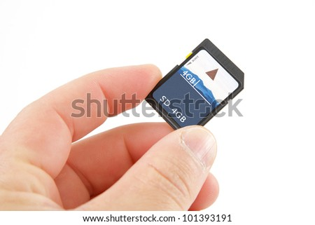 Hand holding an SD card - stock photo