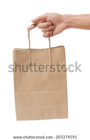 Hand holding and giving paper bag isolated over white background - stock photo