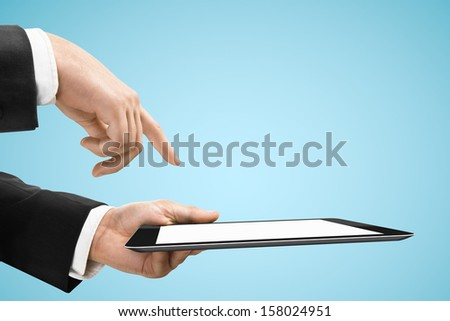 hand holding and pushing tablet on blue background