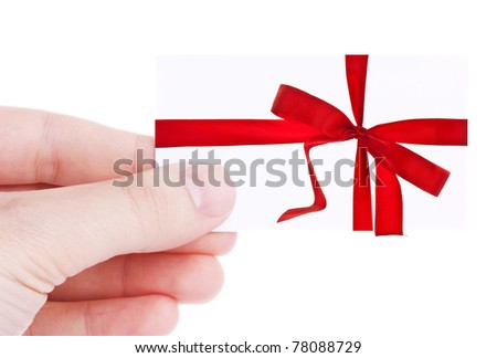 Hand holding and showing a gift card isolated on white background - stock photo