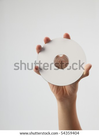 hand holding and showing a printable cd - stock photo