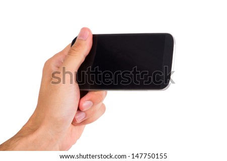 Hand holding and showing smart phone with blank, dark screen, front view, isolated on white background.