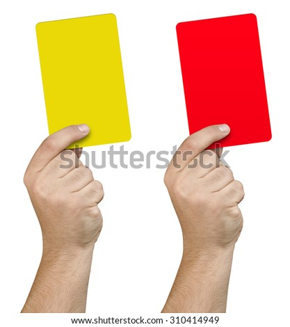 Hand holding and showing yellow and red card isolated