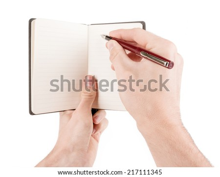 Hand holding and writing on empty notepad (notebook) isolated on white - stock photo