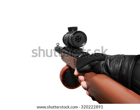 Hand holding automatic gun. Isolated first person view hand holding automatic gun on white background. - stock photo