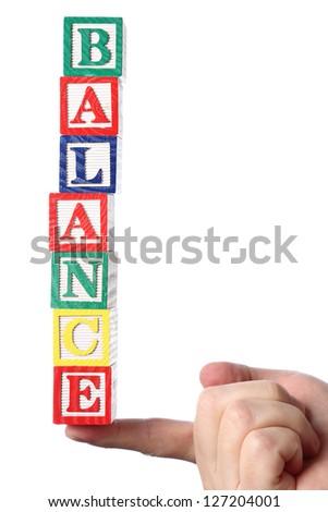 Hand holding balance word - stock photo