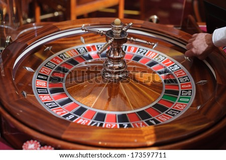 hand holding ball at casino roulette
