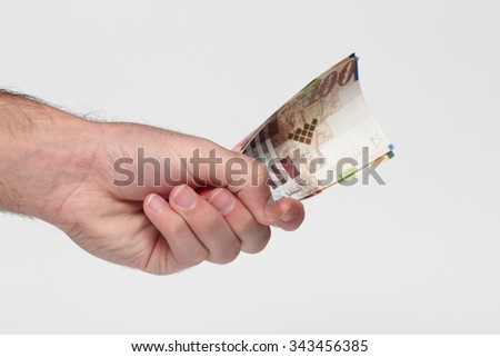 Hand holding banknotes on a white background (Israeli banknotes  , USD )