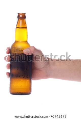 Hand holding beer bottle studio cutout - stock photo