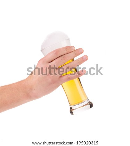 Hand holding beer glass. Isolated on a white background.