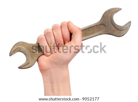 Hand holding big spanner isolated on white background