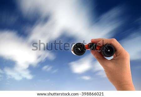 hand holding binocular on moving clouds in nighttime