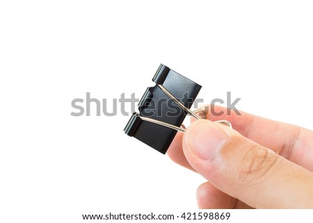 Hand holding black paper clip isolated on white background